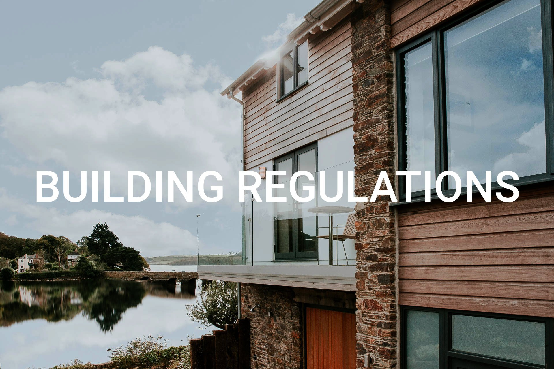 riverside house with cedar and stone cladding