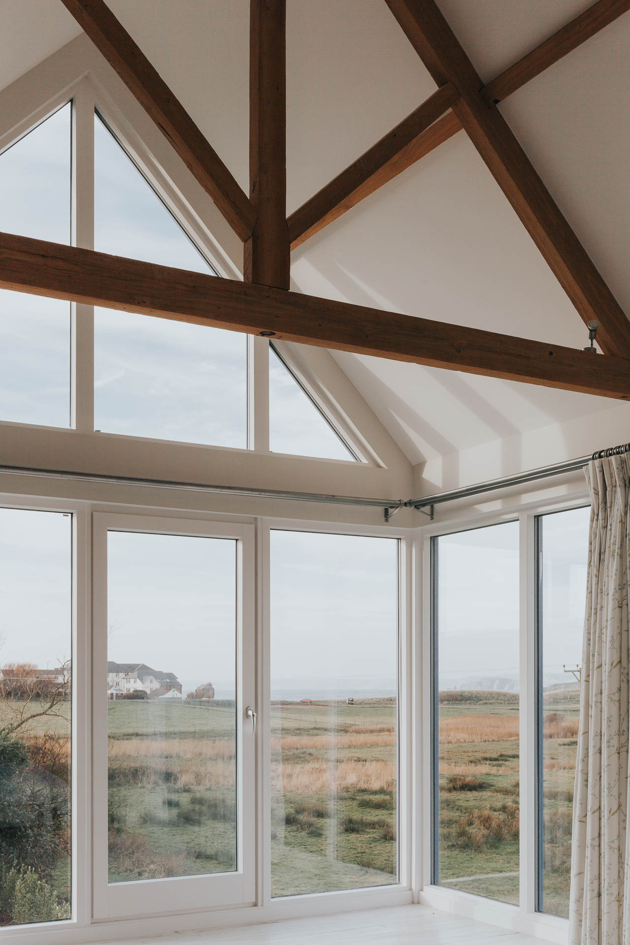 Corner window to Bedroom with views to the sea by Architects in South Devon Andrew Lethbridge Associates