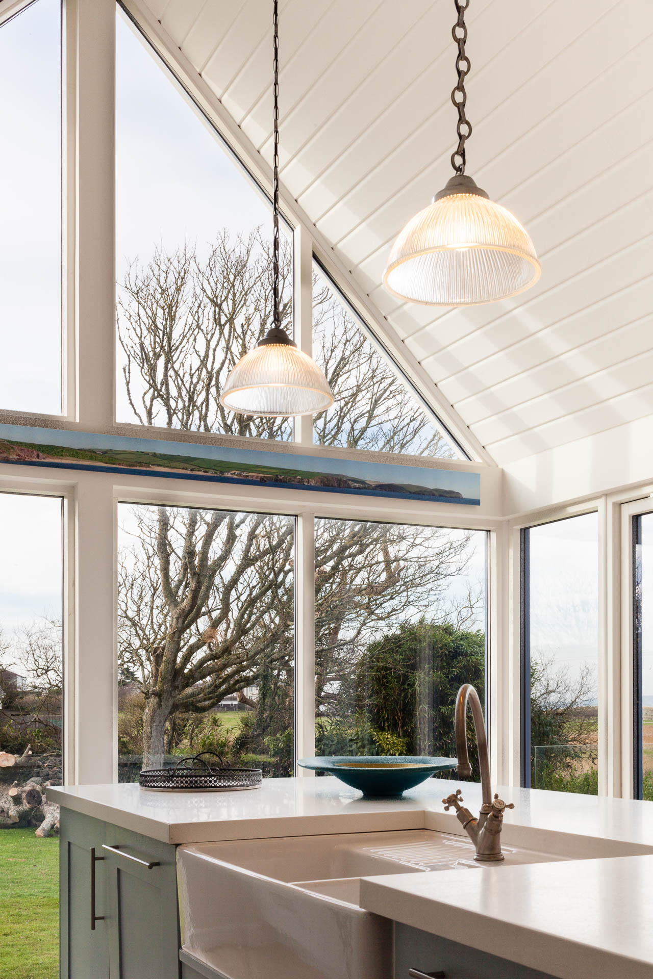 Corner window and timber clad ceiling in beach house kitchen by South Devon Architects Andrew Lethbridge Associates