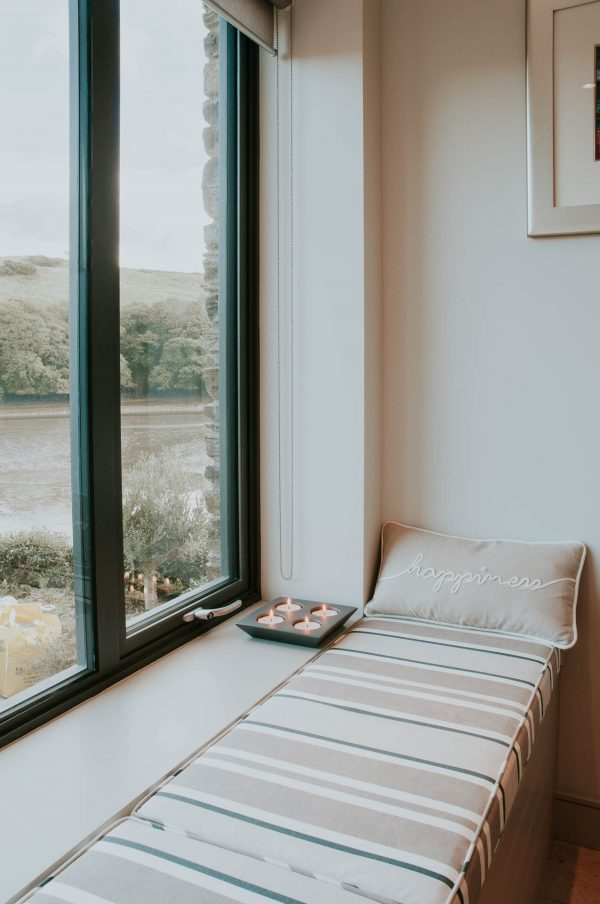 kitchen window seat over looking the river by South Devon Architects Andrew Lethbridge Associates