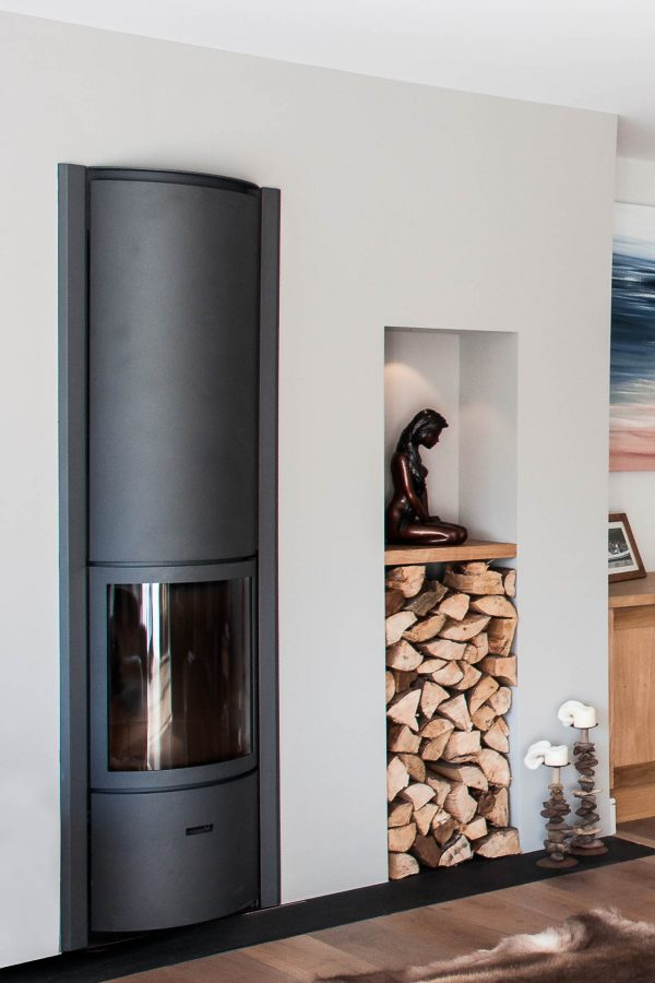 built in log store and stove by South Devon Architects Andrew Lethbridge Associates