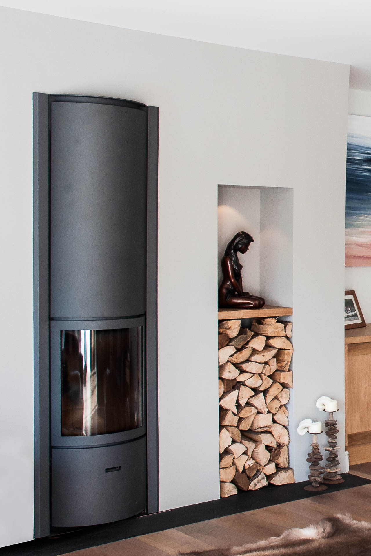 built in log store and recessed stove