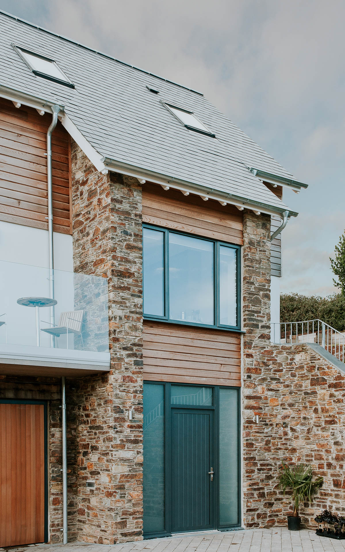 natural stone and ceder cladding to riverside house
