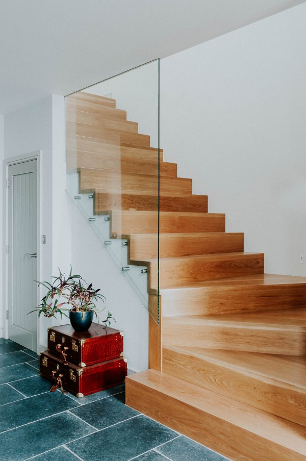 bespoke oak staircase with glass balustrade by South Devon Architects Andrew Lethbridge Associates