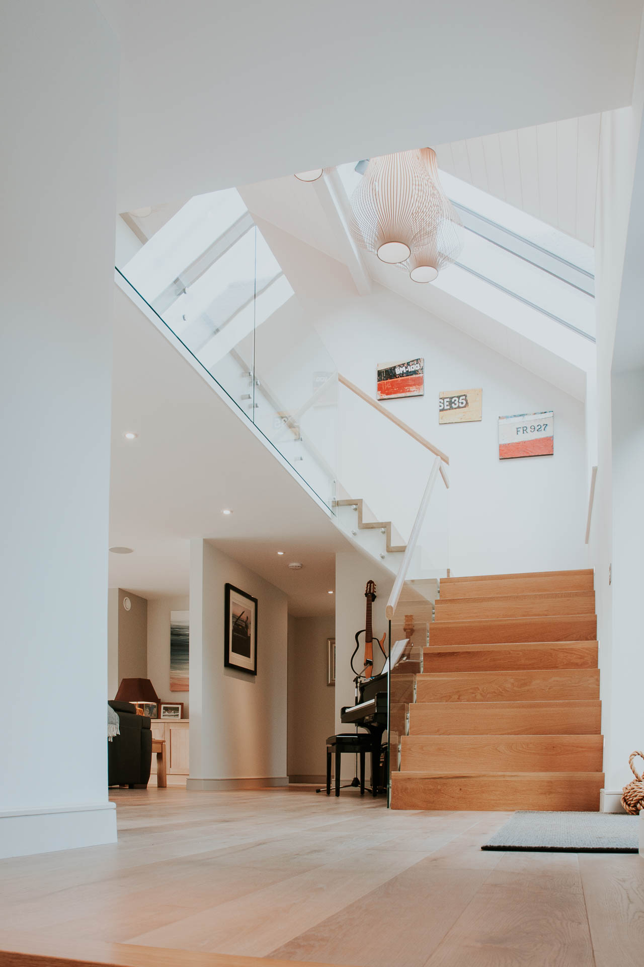 Vaulted hallway with bespoke oak staircase by South Devon Architects Andrew Lethbridge Associates