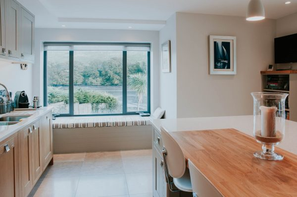 kitchen window seat with river views by South Devon Architects Andrew Lethbridge Associates