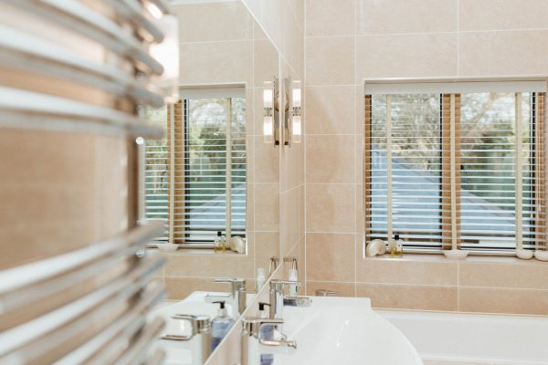 mirror flush with tiles in a bathroom by award winning devon architects andrew lethbridge associates