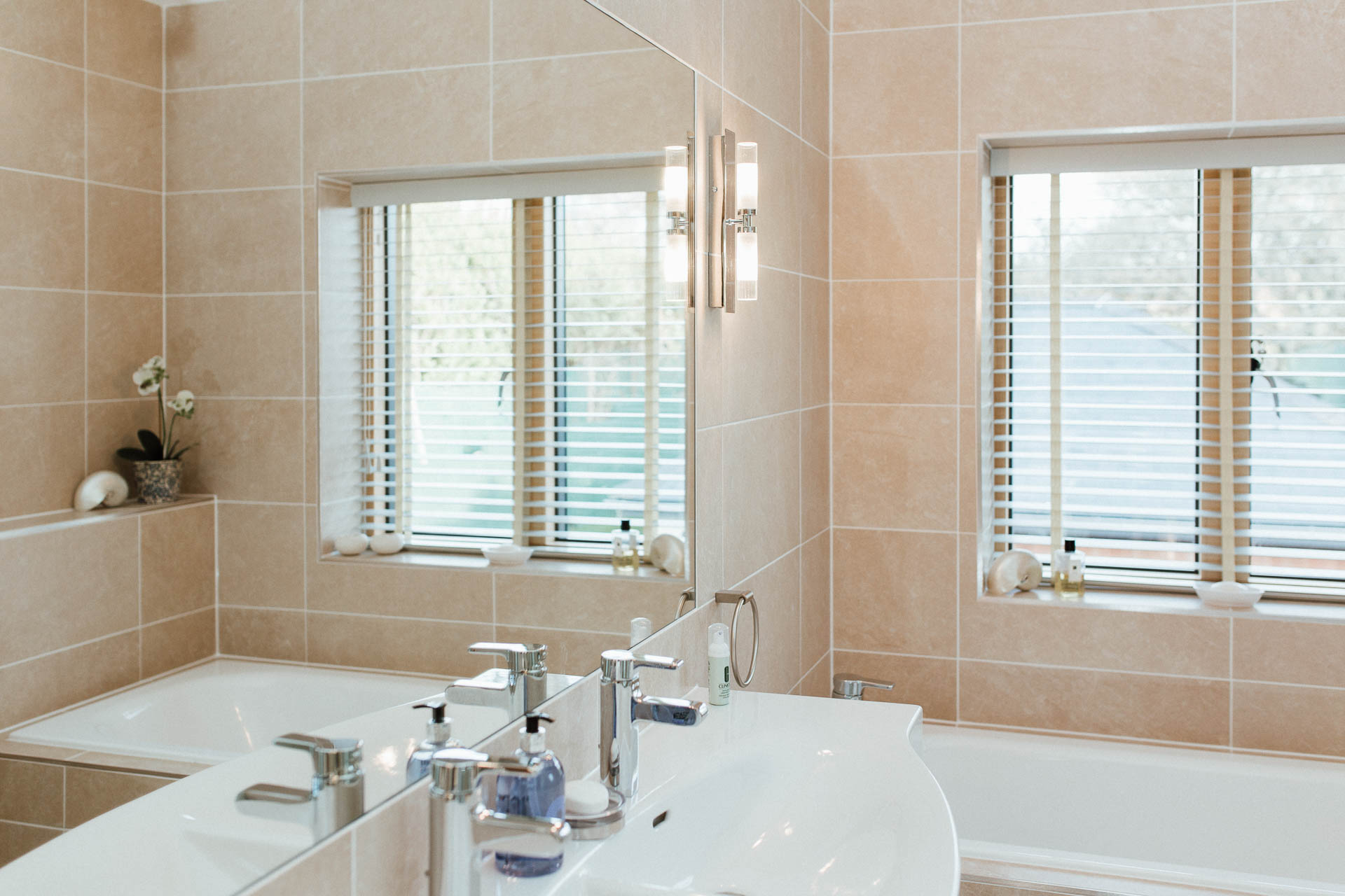 Tiled bathroom with recessed mirror