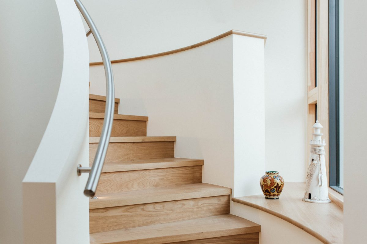 bespoke curved oak staircase in a bespoke new home shortlisted as a 2017 LABC Awards finalist