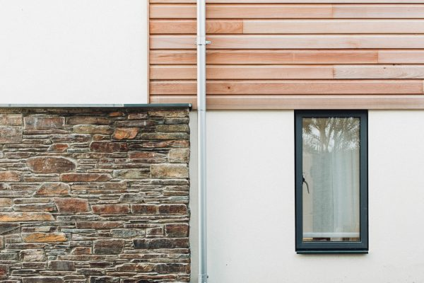 natural stone and cedar cladding to a modern thurlestone beachside home by award winning south devon architects andrew lethbridge associates