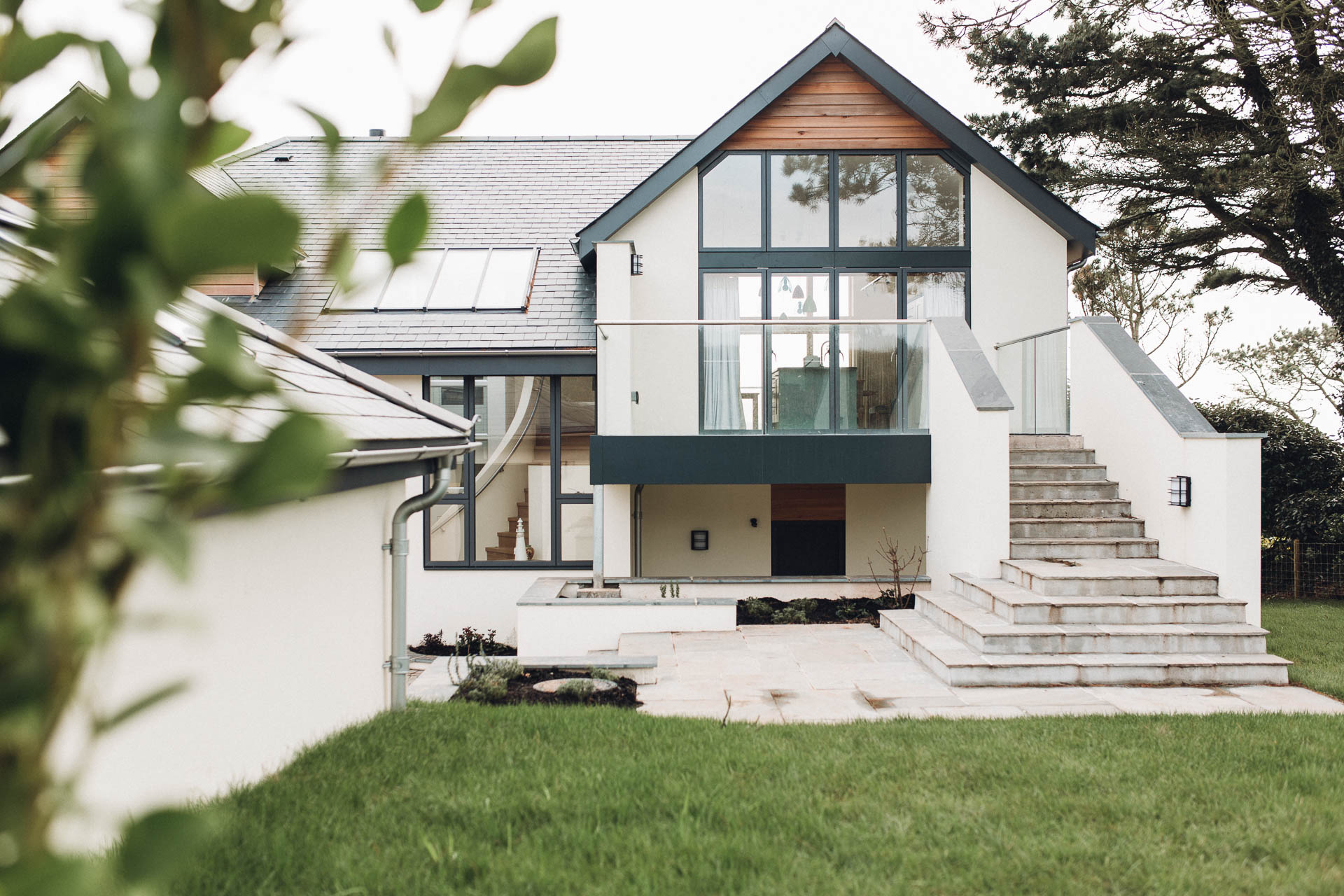 ideal combi windows and frameless glass balcony to a modern thurlestone beach house by devon architects andrew lethbridge associates