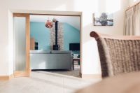 Oak framed sliding pocket door in a new thurlestone beach house by south devon architects andrew lethbridge associates
