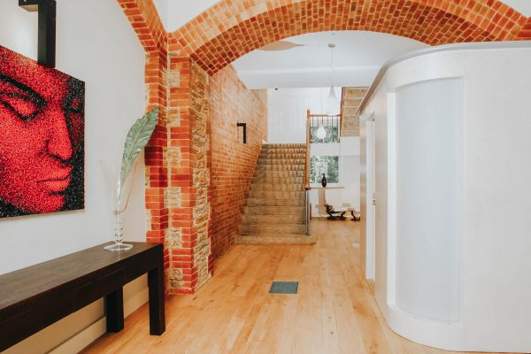 contemporary shower room pod within the brick and plaster hallway of this monastery conversion by award winning devon architects andrew lethbridge associates