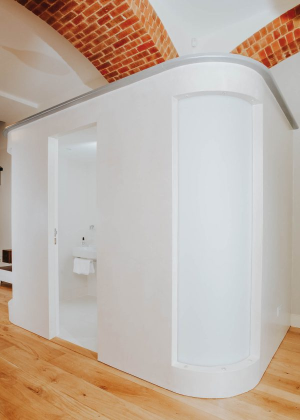 shower room pod within an open plan space in this monastery conversion by devon architects andrew lethbridge associates