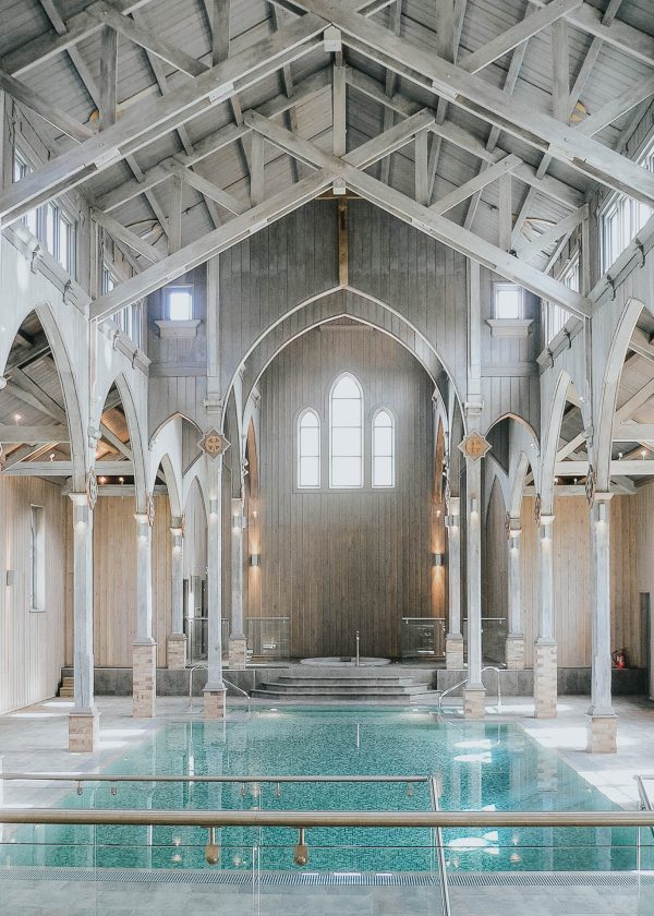 a swimming pool is created in the old timber framed chapel in this monastery conversion by award winning devon architects andrew lethbridge associates