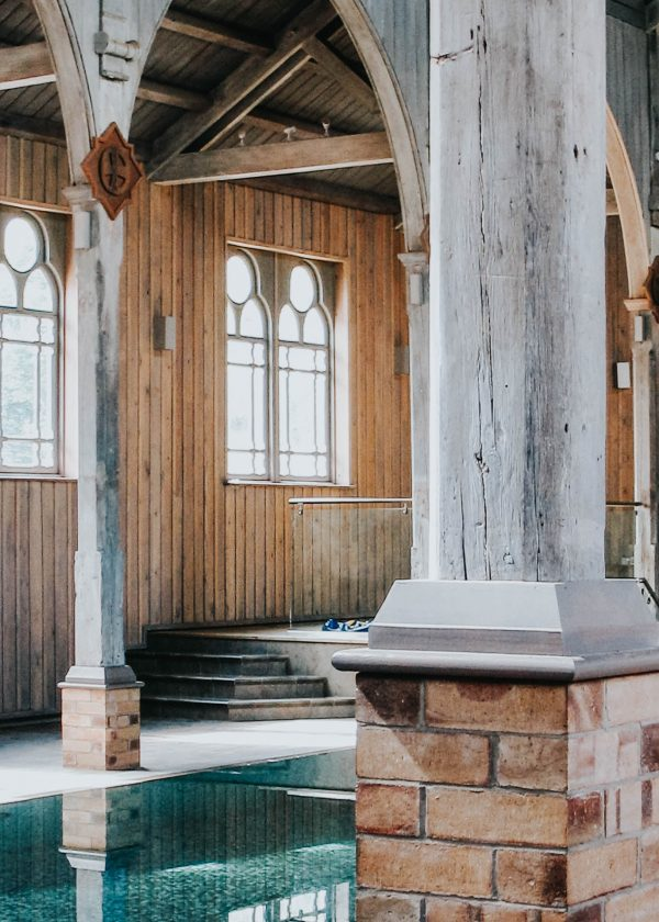Swimming pool created within the original timber framed chapel in this monastery conversion by devon architects andrew lethbridge associates