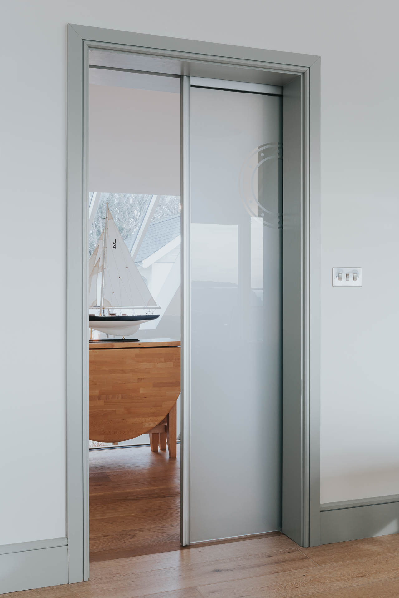 bespoke sliding pocket door with opaque glass by architects in salcombe andrew lethbridge associates