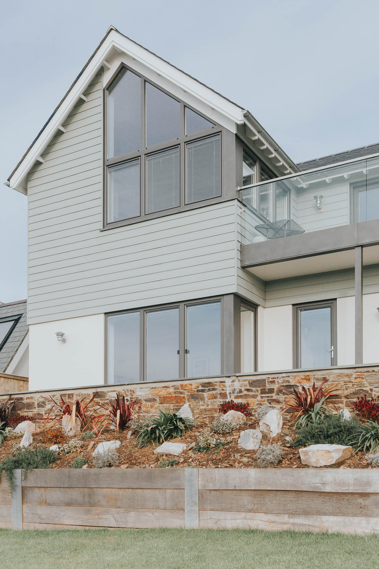 new seaside home with powder coated aluminium windows and fibre cement cladding boards by architects in salcombe andrew lethbridge associates