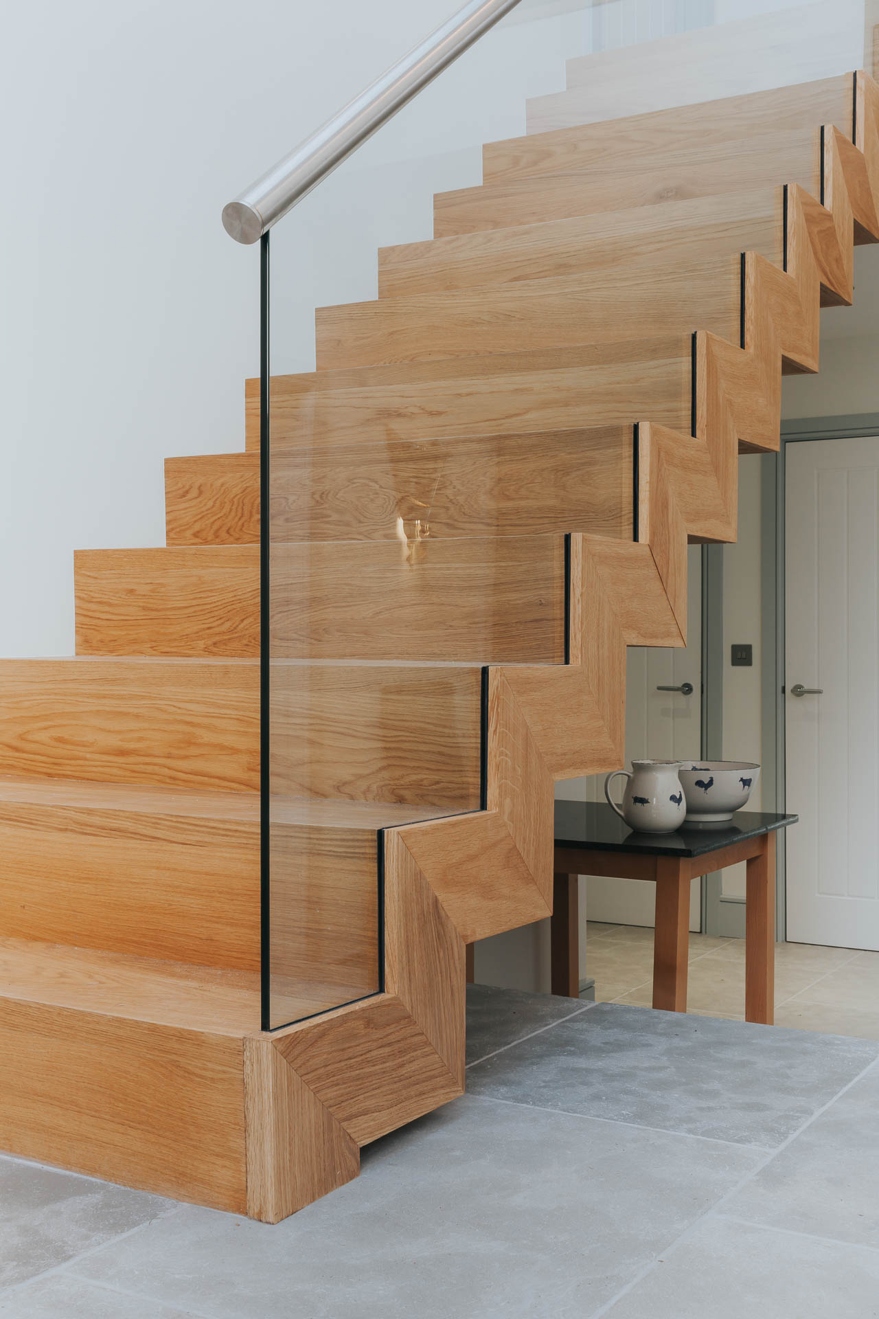 folded timber staircase with glass balustrade