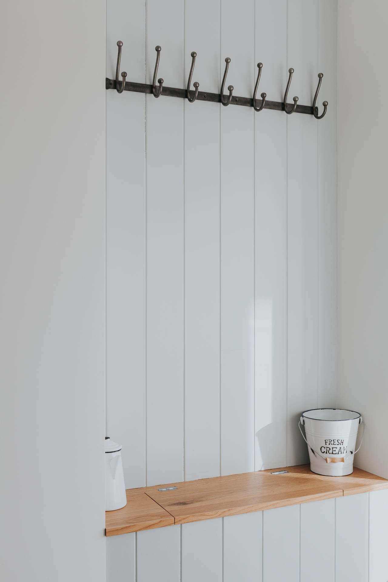 bespoke coat hanging recess with oak seat and timber wall panelling
