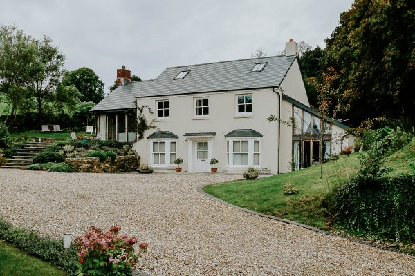 farmhouse with a natural slate roof and sash windows by devon architects andrew lethbridge associates