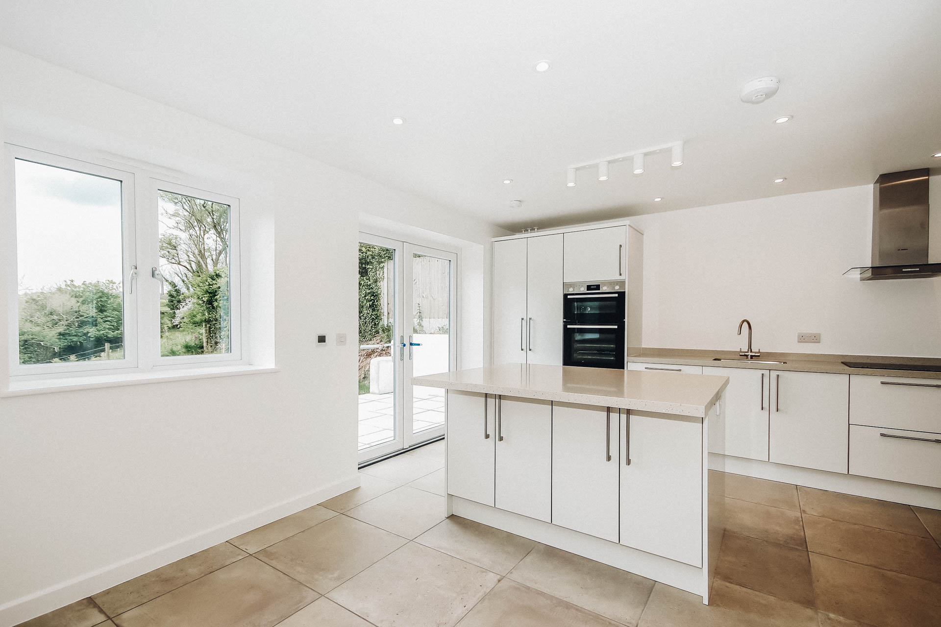 open plan kitchen diner with island in a bespoke new home